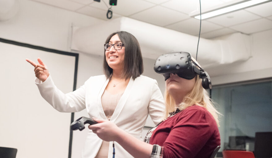 image of Prof. Rosalba Hernandez with student using virtual reality goggles