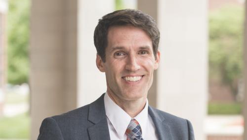 Professor Ben Lough standing outside