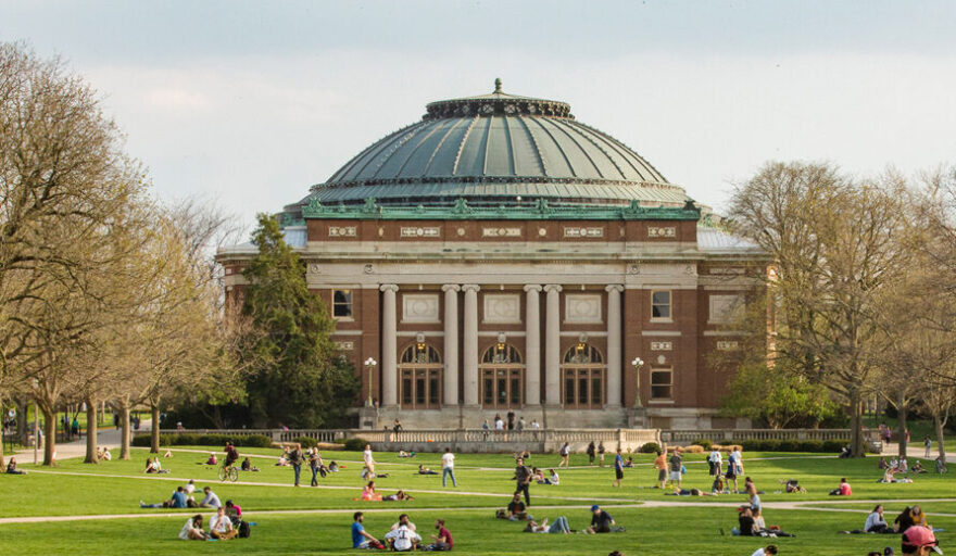 Early spring view of the Quad with students enjoying the weather.