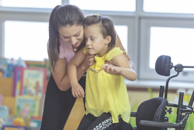 Student working with child in wheelchair