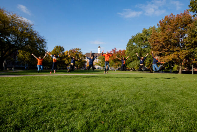 Students jumping on quad