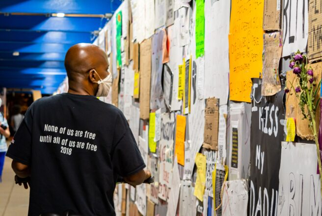 image of man looking at wall fliers