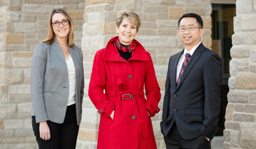 Shown with Professor Kevin Tan are, from left: director of instruction Nicole Rummel and superintendent Lindsey Hall, both of Mahomet-Seymour CUSD No. 3.