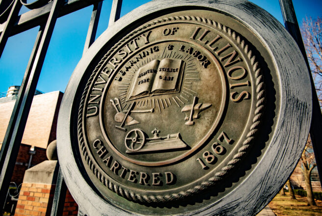 image of gate with University of Illinois seal
