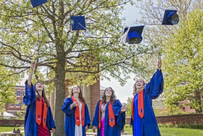grads throwing caps in air