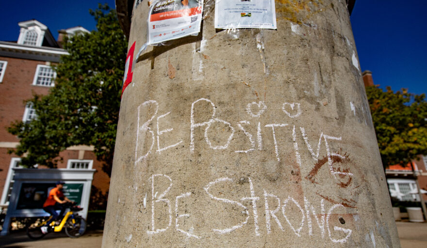 image of message written on pole on Quad